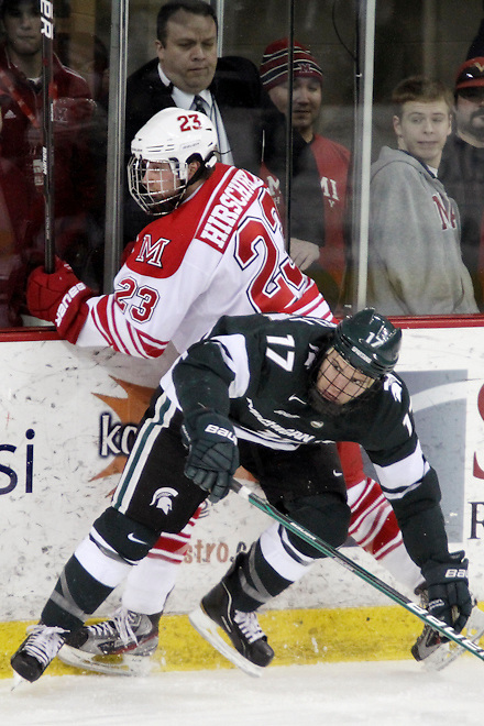10 Mar 12: Matt Crandell (MSU - 17), Alden Hirschfeld (Miami - 23) Miami University sweeps Michigan State University at Steve Cady Arena in Oxford, OH in Round 2 of the CCHA Playoffs to advance to the semi-finals in Detroit. (©Rachel Lewis)