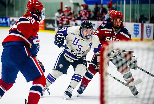 Thomas Williams works around the net during a men's hockey game against Saint Mary's University January 9, 2016 at St. Thomas Ice Arena. The Tommies  beat the Cardinals 6-2. (Mike Ekern/University of St. Thomas)