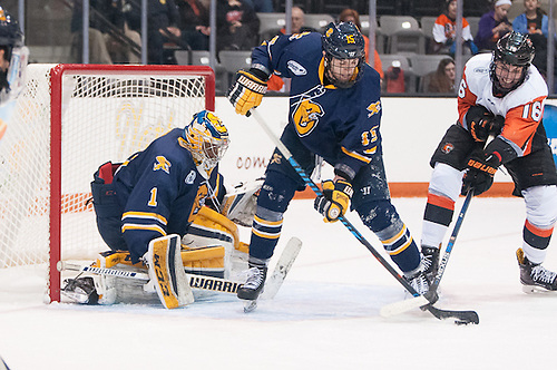 Erik Brown (16 - RIT) attempts to get the puck from Cody Boyd (15 - Canisius) (Omar Phillips)