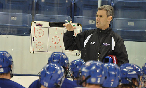 Massachusetts-Lowell coach Norm Bazin talks to players at a practice. (Bob Ellis)