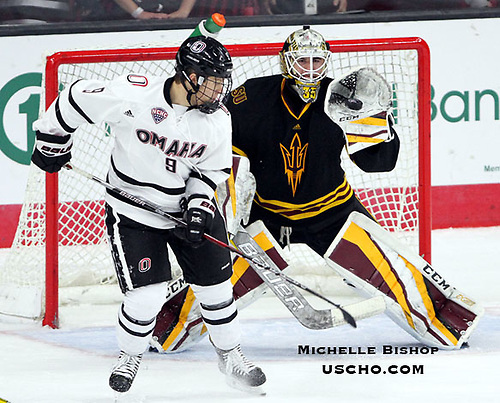 ASU goalie Joey Daccord catches the puck during the third period. Omaha and Arizona State tied 4-4 Saturday night at Baxter Arena. (Photo by Michelle Bishop) (Michelle Bishop)