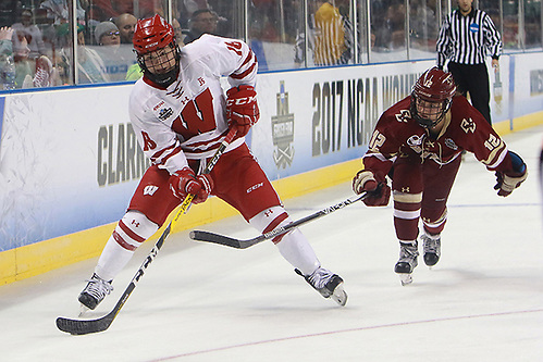 Abby Roque (Wisconsin-18) and Kenzie Kent (Boston College-12) in a semifinal game during the 2017 NCAA Frozen Four at Family Arena in St. Charles, Mo. (Don Adams Jr.)