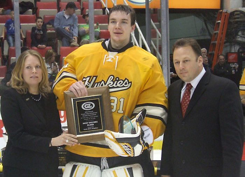 Michigan Tech goaltender Pheonix Copley accepts the MVP award at the 2012 Great Lakes Invitational in Detroit. The sophomore signed with the Washington Capitals on March 19, 2014. (Matt Mackinder)