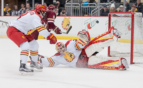 Justin Kapelmaster (35 - Ferris State) stacks the pads as a shot by Austin Cangelosi (9 - Boston College) sails just wide (Omar Phillips)