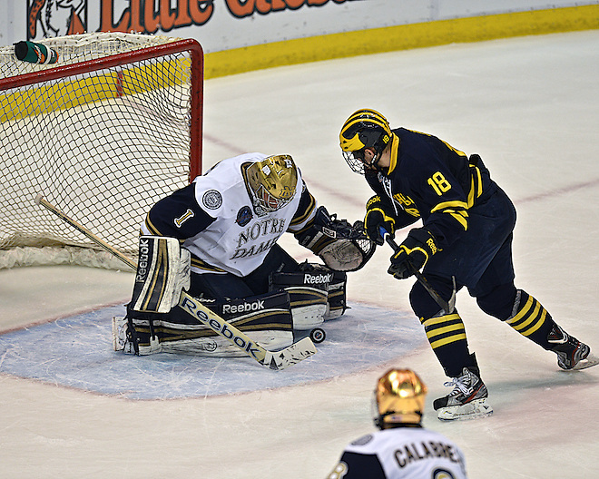 Notre Dame goaltender Steven Summerhays (1) makes an incredible save against Michigan forward Andrew Copp (18)   (Eric Kelley/Eric Kelley, d3photography.com)