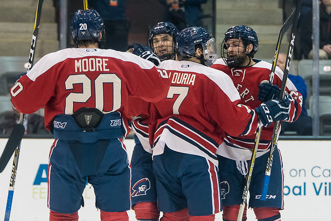 Robert Morris players celebrate a goal by Brady Ferguson (12 - Robert Morris) (2017 Omar Phillips)