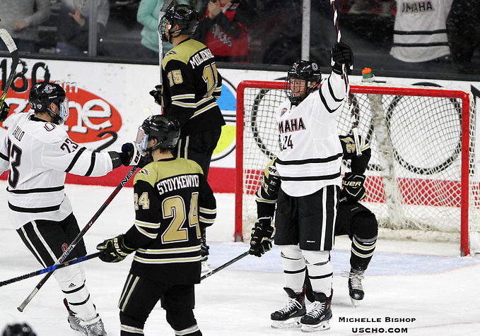 Omaha's Cole Pickup (24) celebrates his first collegiate goal after scoring an empty-netter during the third period. Omaha beat Western Michigan 6-2 Friday night at Baxter Arena. (Photo by Michelle Bishop) (Michelle Bishop)