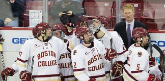 Kevin Lohan (BC - 24) was mobbed by teammates on his return to the bench after scoring his first goal as an Eagle. The grad student transferred to BC from Michigan. His two goals tonight doubled his career totals. The Boston College Eagles clinched the Hockey East regular season championship with their 6-3 win over the visiting University of Maine Black Bears on Friday, February 23, 2018, at Kelley Rink in Conte Forum in Chestnut Hill, Massachusetts. (Melissa Wade)