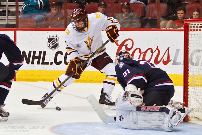 2016Jan10: Ryan Belonger (ASU - 16), Rob Nichols (UConn - 31). The UConn Huskies shut out the Arizona State Sun Devils 3-0 in the Consolation Game of the inaugural Desert Hockey Classic at Gila River Arena in Glendale, AZ. (©Rachel Lewis)