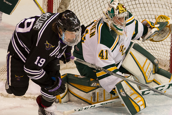 8 Jan 16: Brad McClure (Minnesota State - 19), Ate Tolvanen (Northern Michigan - 41). The Minnesota State University Mavericks host the Northern Michigan University Wildcats in a WCHA conference matchup at Verizon Wireless Center in Mankato, MN. (Jim Rosvold)