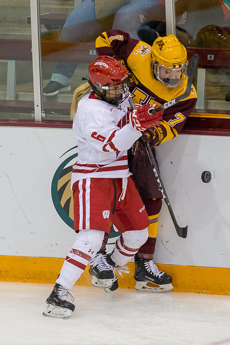 Taylor Williamson is checked by Presly Norby. The University of Wisconsin Badgers play against the University of Minnesota Golden Gophers in the Championship game of the 2018 WCHA Final Faceoff game at Ridder Arena in Minneapolis, MN. (Jim Rosvold/WCHA)