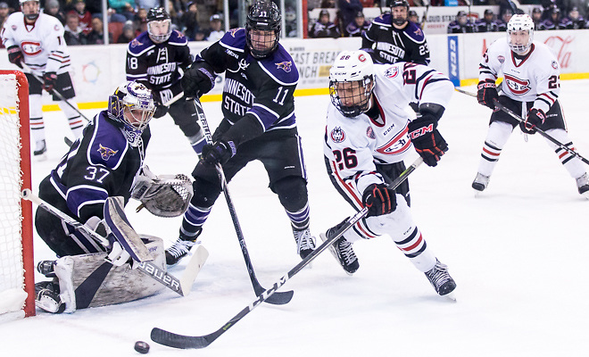 Connor LaCouvee (MSU-37) Easton Brodzinski (SCSU-26) Jarred Spooner (MSU-11) 2018 Jan. 12 The St.Cloud State University Huskies host Mankato State University n a non conference matchup at the Herb Brooks National Hockey Center in St. Cloud, MN (Bradley K. Olson)