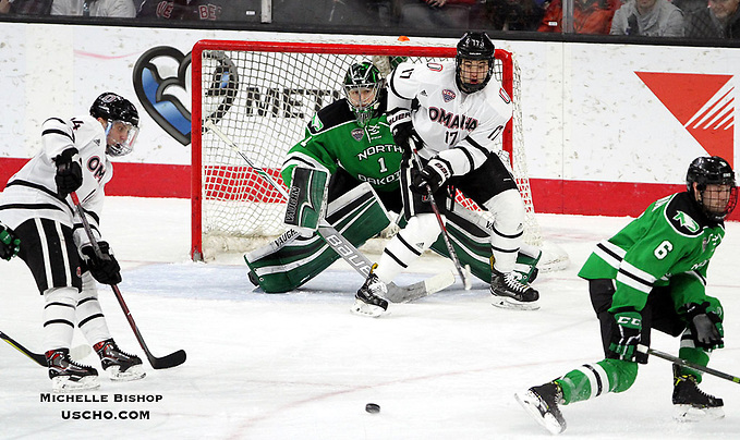 Omaha's Teemu Pulkkinen (14) sets to redirect a shot for a power-play goal during the second period. Omaha beat North Dakota 6-3 Friday night at Baxter Arena. (Photo by Michelle Bishop) (Michelle Bishop)