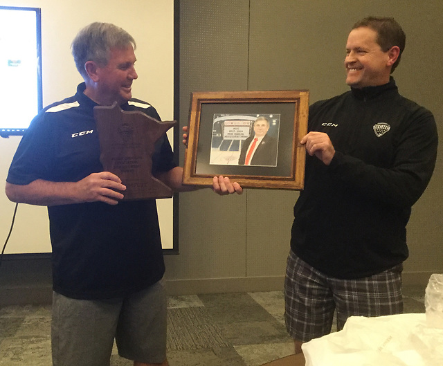 Don Adam (right) presents the Mark Rudolph Award to Ron Foyt. (photo: NCHC)