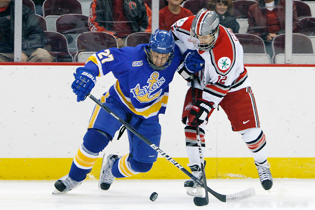 2 Dec 11: Matt Bruneteau (LSSU - 27), Travis Statchuk (OSU - 12) Ohio State beats Lake Superior State at Value City Arena in Columbus, OH. (©Rachel Lewis)