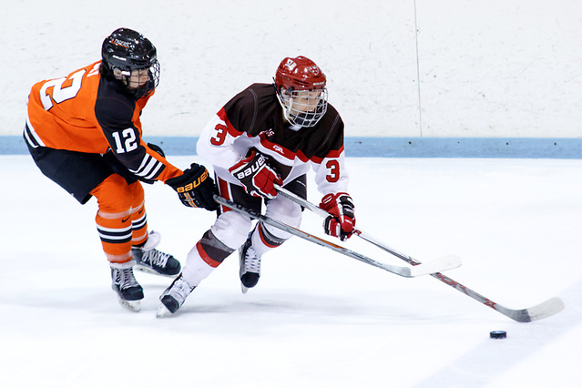 Nadine Edney (St. Lawrence - 3) plays the puck as Morgan Sly ( Princeton - 12) defends. (Shelley M. Szwast)