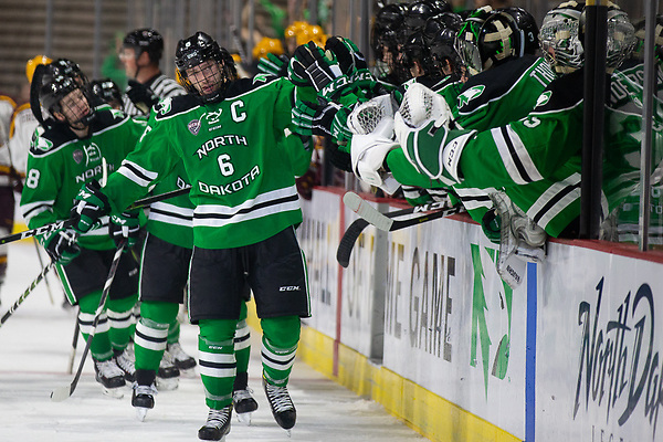 27 Oct 18: The University of North Dakota Fighting Hawks host the University of Minnesota Golden Gophers in the 2018 US Hockey Hall of Fame Game at Orleans Arena in Las Vegas, NV. Photo: Jim Rosvold/University of Minnesota (Jim Rosvold/University of Minnesota)