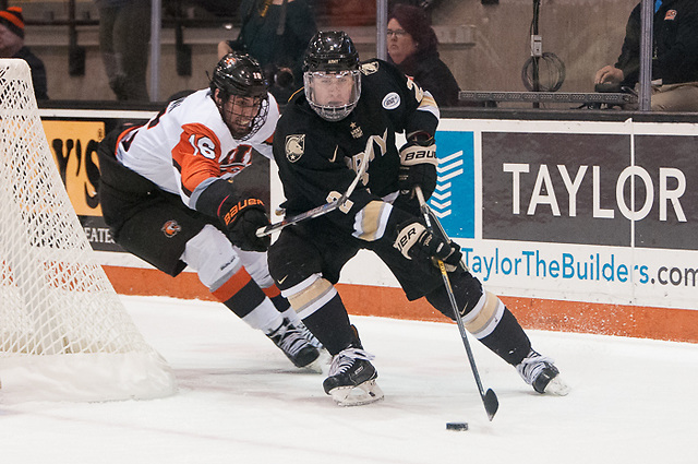 Dalton MacAfee (2 - Army West Point) shields the puck from Erik Brown (16 - RIT) (Omar Phillips)