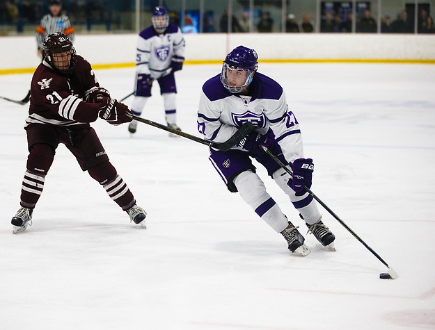 Brett Gravelle skates past a defender during a men's hockey MIAC Championship game versus Augsburg March 4, 2017 at the St. Thomas Ice Arena in Mendota Heights. The Tommies fell to the Auggies 2-3. (Mike Ekern/University of St. Thomas)