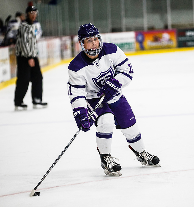Johnny Panvica skates with the puck during a men's ice hockey game against the University of Wisconsin-Eau Claire on November 9, 2017, in the St. Thomas Ice Arena in Mendota Heights. UST won the game by a final score of 5-3. (Mark Brown/University of St. Thomas)