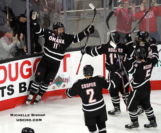 Omaha celebrates Mason Morelli's (11) goal during the second period. Omaha beat Western Michigan 6-3 Saturday night at Baxter Arena. (Photo by Michelle Bishop) (Michelle Bishop)