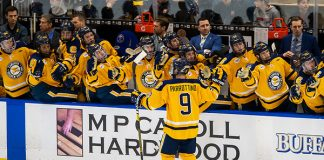 Canisius players celebrate a goal by David Parrottino (9 - Canisius) (2019 Omar Phillips)