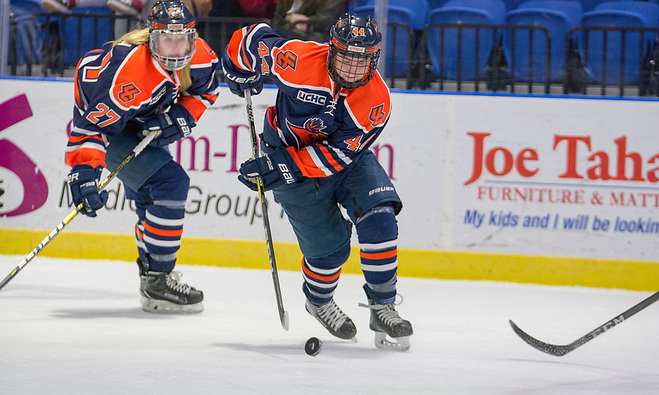 Rebecca Brown (on left) and Olivia Hirschy (on right) lead Utica (Utica Athletics)