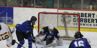 Hunter Vorva anchors Marian in net. (Larry Radloff/Larry Radloff, d3photography.com)