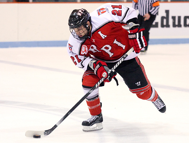 Chase Polacek (RPI - 21) carries the puck through the neutral zone. The Rennselaer Engineers visited Princeton's Hobey Baker Rink, defeating the Princeton Tigers 5-2. (Shelley M. Szwast)