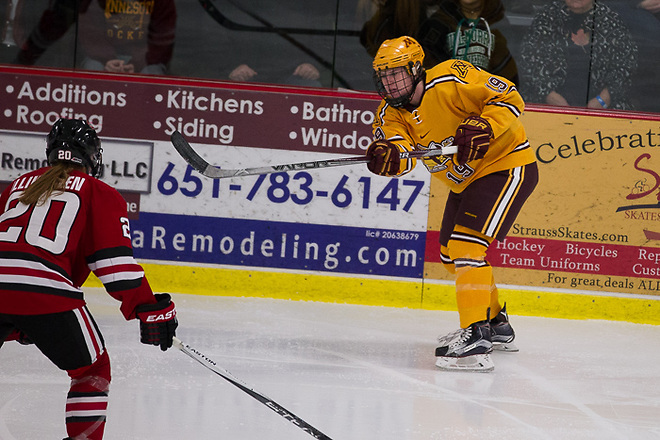 11 Dec 15: Suvi Ollikainan (St. Cloud -20), Kelly Pannek (Minnesota - 19). The University of Minnesota Golden Gophers play against the St. Cloud State University Huskies in the U.S. Hockey Hall of Fame Game at the Roseville Skating Center in Roseville, MN. (Jim Rosvold)