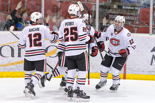 Robby Jackson (SCSU-23) Nick Perbix (SCSU-25) Jack Ahcan (SCSU-12) 2019 February 9 St. Cloud State University hosts Colorado College in a NCHC contest at the Herb Brooks National Hockey Center (Bradley K. Olson)