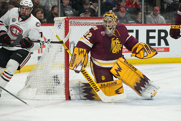 Nick Poehling (SCSU-7) Hunter Shepard (Minnesota-Duluth -32) 2019 March 23 University of Minnesota Duluth and St. Cloud State University meet in the championship game of the NCHC Frozen Face Off at the Xcel Energy Center in St. Paul, MN (Bradley K. Olson)