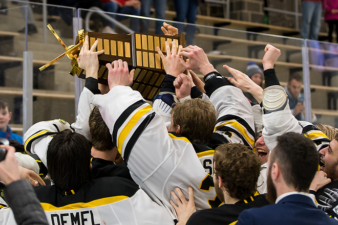 AIC players celebrate winning the 2019 Atlantic Hockey championship (2019 Omar Phillips)