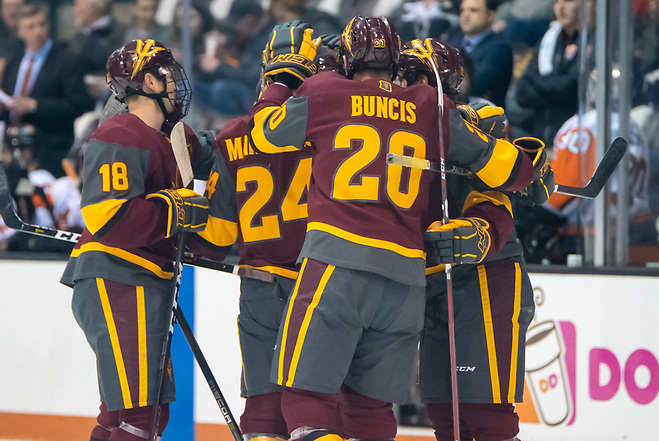 Arizona State players celebrate an early first period goal in a 6-1 win at RIT (2019 Omar Phillips)