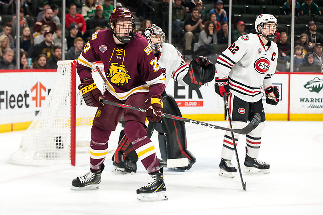Riley Tufte  (Minnesota-Duluth-27 David Hrenak (SCSU-34) 2019 March 23 University of Minnesota Duluth and St. Cloud State University meet in the championship game of the NCHC  Frozen Face Off at the Xcel Energy Center in St. Paul, MN (Bradley K. Olson)