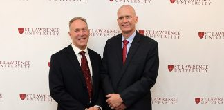 St. Lawrence director of athletics Bob Durocher (left) introduces new head coach Brent Brekke on May 25. (photo: St. Lawrence Athletics)
