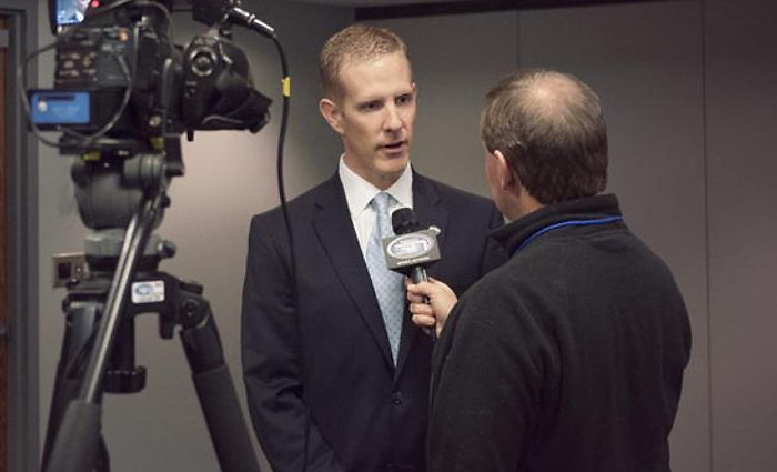 NCHC commissioner Josh Fenton gets interviewed at 2013 media day. (NCHC)
