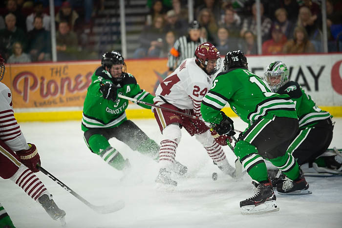 A pile in the crease as Denver's Bobby Brink tries for a rebound, North Dakota vs. Denver at Magness Arena, Nov. 15, 2019. (Candace Horgan)