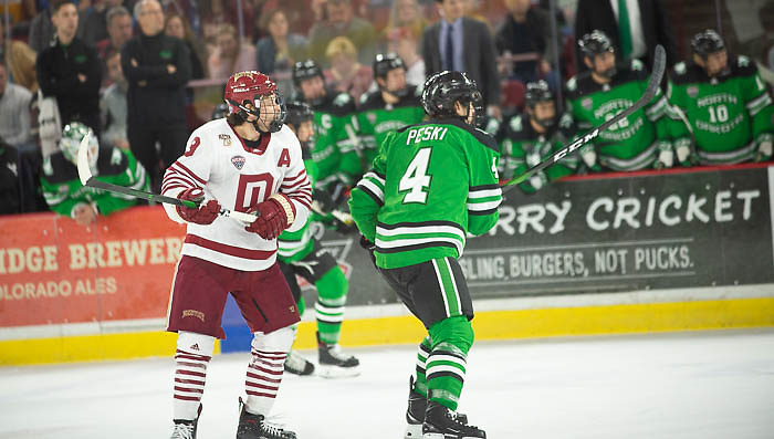 Tyson McLellan of Denver looks up ice, North Dakota vs. Denver at Magness Arena, Nov. 15, 2019. (Candace Horgan)