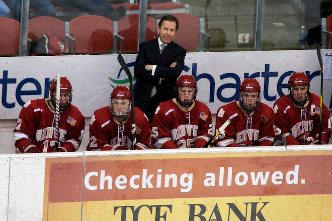 16 Dec 11: George Gwozdecky (Denver -Head Coach)  The St. Cloud State Huskies host the Denver University Pioneers in a WCHA match up at the National Hockey Center in St. Cloud, MN. (Jim Rosvold)