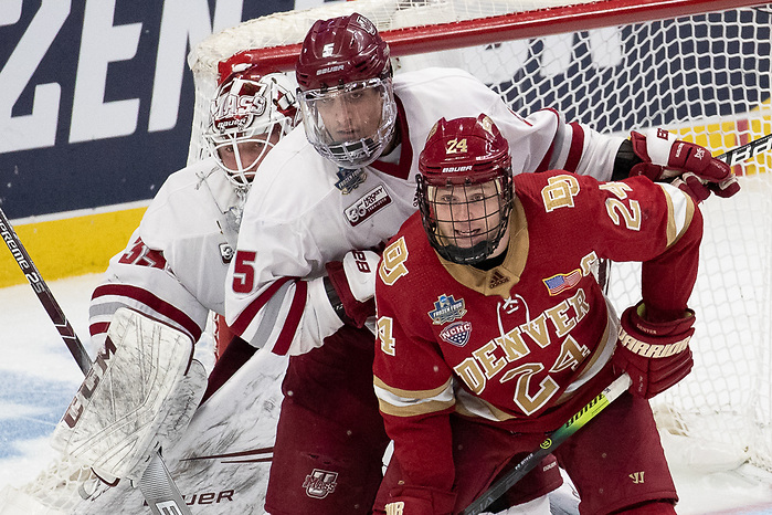11 Apr 19: The University of Massachusetts Minutemen play against the Denver University Pioneer in a national semifinal of the 2019 NCAA Division I Men's Frozen Four at the KeyBank Center in Buffalo, NY. (Jim Rosvold)