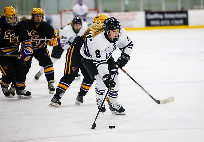 Maddy Fiedler takes the puck down the ice. (Mike Ekern/University of St. Thomas)