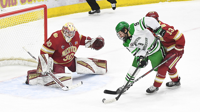 February 15, 2020 a NCAA men's ice hockey game between the Denver Pioneers and the University of North Dakota at Ralph Engelstad Arena, Grand Forks, ND. Photo by Russell Hons (Russell Hons)