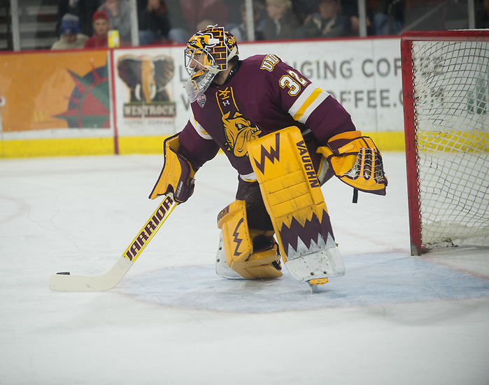 Hunter Shepard of UMD plays the puck. Minnesota Duluth at Denver at Magness Arena, November 17, 2018. (Candace Horgan)