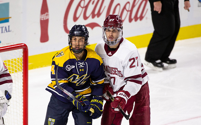 AMHERST, MA - NOVEMBER 22: Jake McLaughlin #27 of the Massachusetts Minutemen and Tyler Drevitch #4 of the Merrimack College Warriors during NCAA men's hockey at the Mullins Center on November 22, 2019 in Amherst, Massachusetts. The game ended in a 2-2 tie. (Photo by Rich Gagnon/USCHO) (Rich Gagnon)