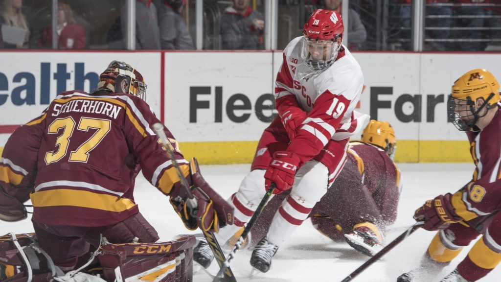 Rangers sign Wisconsin blueliner Miller, who gives up final two years of NCAA eligibility