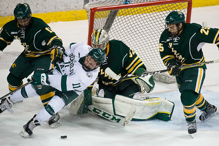 08 Dec 17: Adam Rockwood (Northern Michigan - 11), Charlie Combs (Bemidji State - 11), Mathias Israelsson (Northern Michigan - 32), Philip Beaulieu (Northern Michigan - 25). The Bemidji State University Beavers host the Northern Michigan University Wildcats in a WCHA Conference matchup at the Sanford Center in Bemidji, MN. (Jim Rosvold)