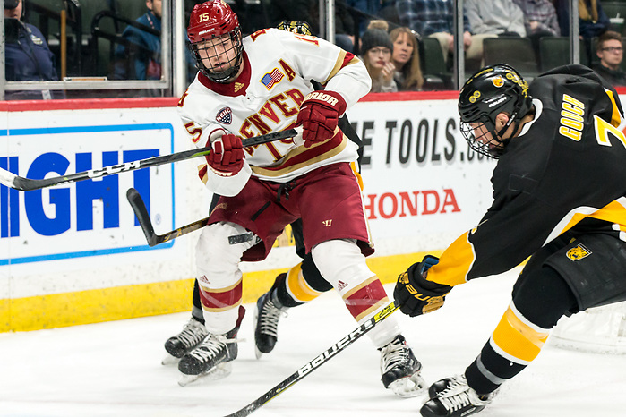 Ian Mitchell (Denver-15) Trevor Gooch (Colorado College-2) 2019 March 23 Denver and Colorado College meet in the 3rd place game of the NCHC Frozen Face Off at the Xcel Energy Center in St. Paul, MN (Bradley K. Olson)
