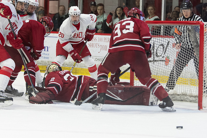 The puck slides harmlessly past the crease as Cornell put third period pressure on Harvard (2020 Omar Phillips)